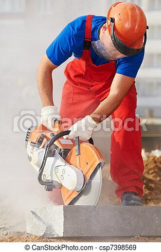 builder at cutting curb work - csp7398569