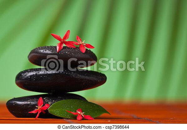 Spa & massage still life : balancing stones - csp7398644