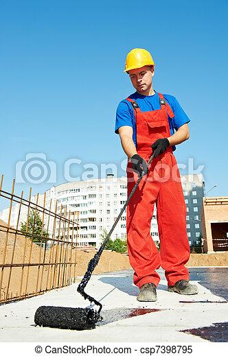 builder worker at roof insulation work - csp7398795