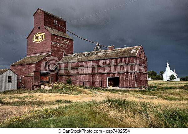 Prairie Grain Elevator and Church - csp7402554