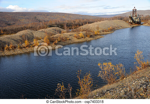 Historic Alaska Gold Dredge in Fall - csp7403318