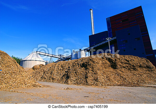 bio power plant with storage of wooden fuel against blue sky - csp7405199