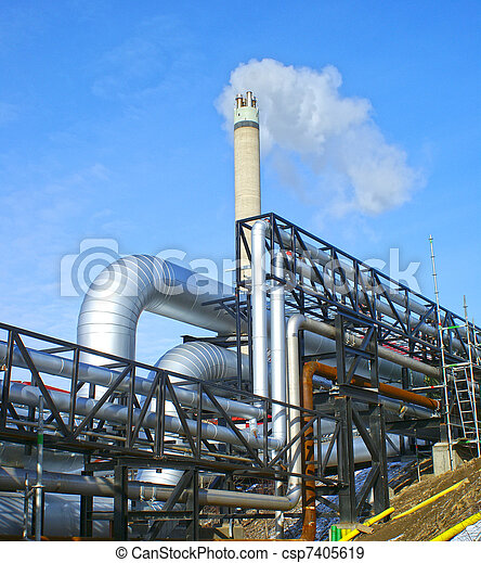 Industrial zone, Steel pipelines and valves against blue sky - csp7405619
