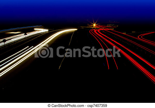 car light trails in red and white on night road - csp7407359