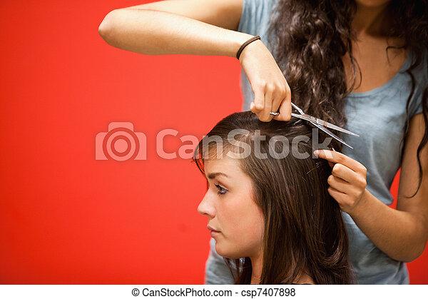 Student hairdresser cutting hair - csp7407898