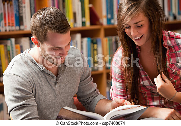 Students reading a book - csp7408074