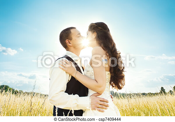 sunny kiss. bride and groom - csp7409444
