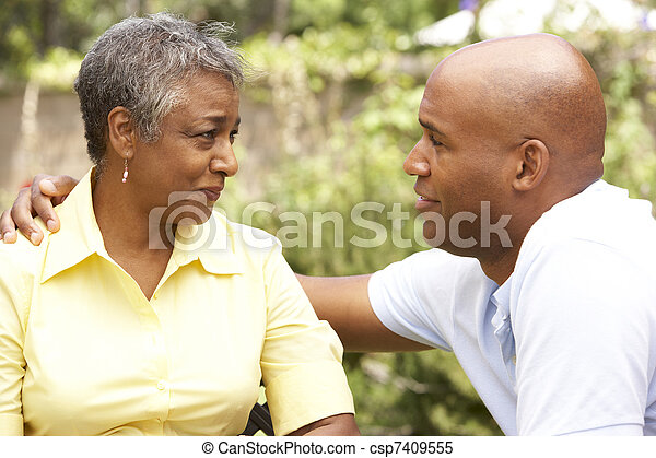 Senior Woman Being Consoled By Adult Son - csp7409555