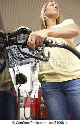 Female Motorist Filling Car With Diesel At Petrol Station - csp7409814