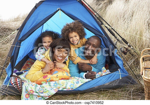 Young Family Relaxing Inside Tent On Camping Holiday - csp7410952
