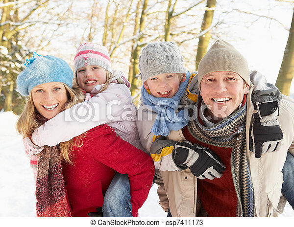 Family Having Fun Snowy Woodland - csp7411173
