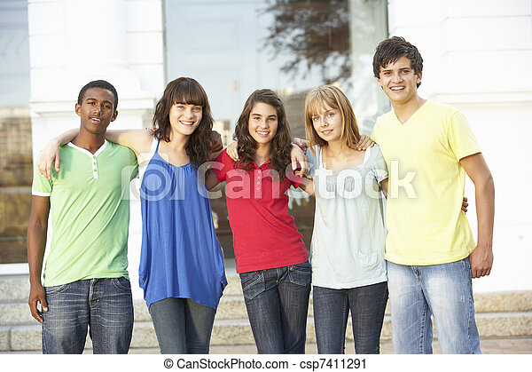 Group Of Teenage Students Standing Outside College Building - csp7411291
