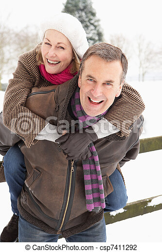 Senior Couple Standing Outside In Snowy Landscape - csp7411292