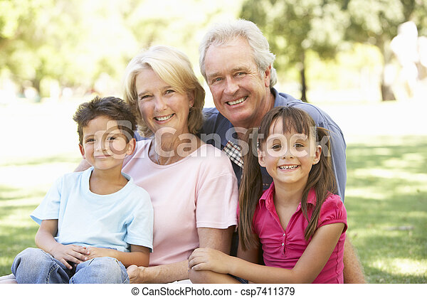 Grandparents And Grandchildren Enjoying Day In Park - csp7411379