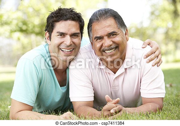 Father With Adult Son In Park - csp7411384