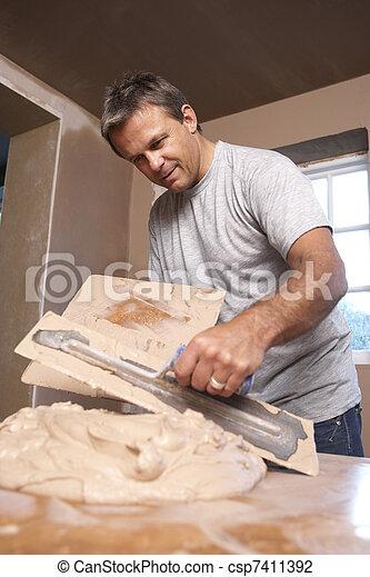 Plasterer Mixing Plaster - csp7411392