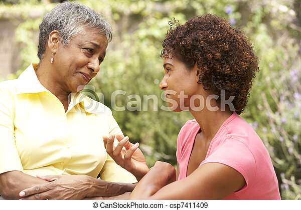 Senior Woman Being Consoled By Adult Daughter - csp7411409