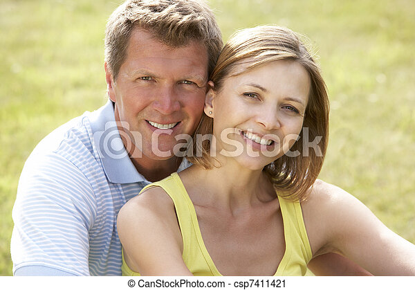 Middle aged couple having fun in countryside - csp7411421