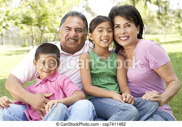 Grandparents In Park With Grandchildren - csp7411482