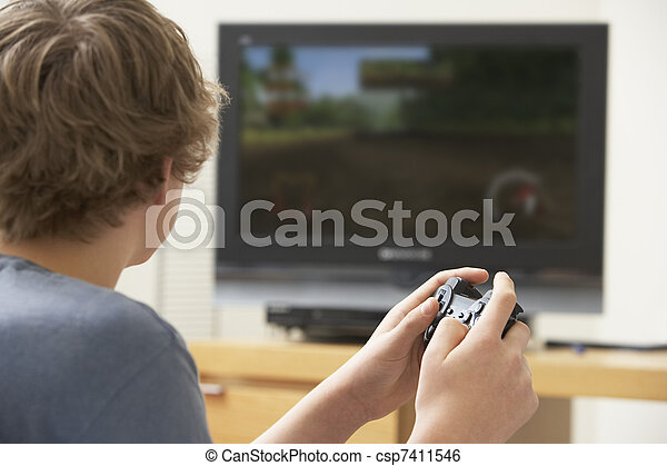 Teenage Boy Playing With Game Console - csp7411546