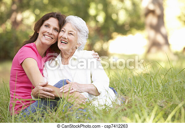 Senior Woman With Adult Daughter In Park - csp7412263