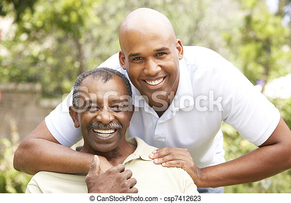 Senior Man Hugging Adult Son - csp7412623