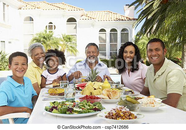 Family Eating An Al Fresco Meal - csp7412686