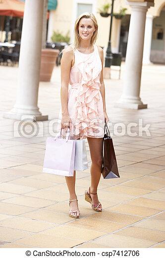Young Woman Enjoying Shopping Trip - csp7412706