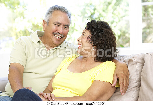 Senior Couple Relaxing At Home Together - csp7412901