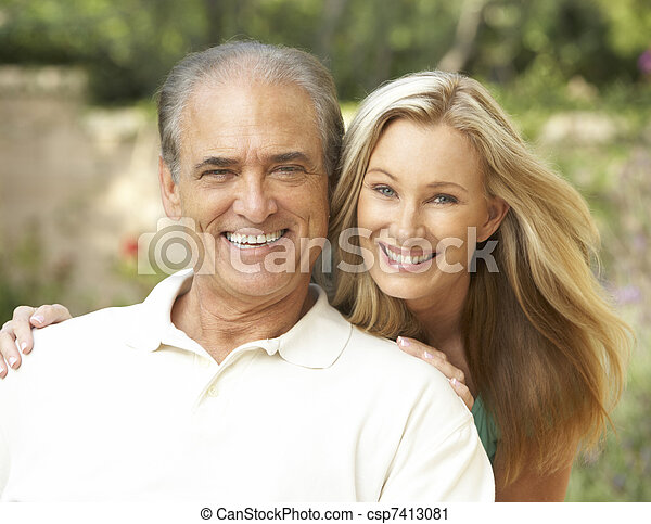 Senior Man Hugging Adult Daughter - csp7413081