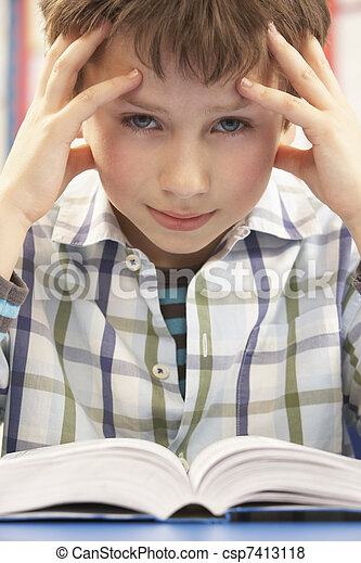 Stressed Schoolboy Studying In Classroom - csp7413118