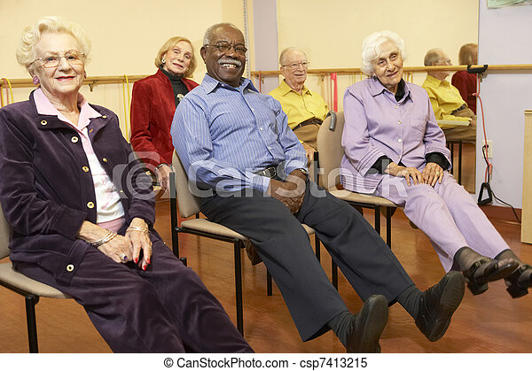 Senior adults in a stretching class - csp7413215