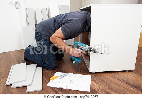 Man Assembling Flat Pack Furniture - csp7413267