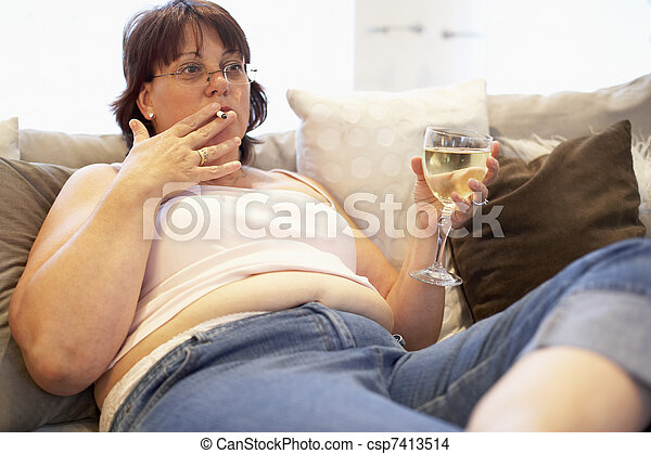 Overweight Woman Relaxing On Sofa - csp7413514