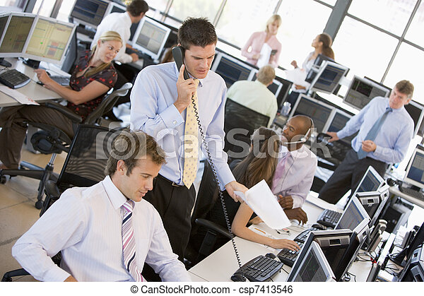 View Of Busy Stock Traders Office - csp7413546