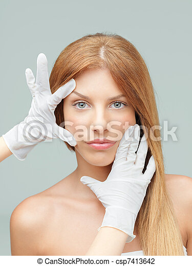 young woman being examinated plastic surgeons' hands - csp7413642