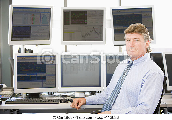 Portrait Of Stock Trader In Front Of Computer Monitors - csp7413838