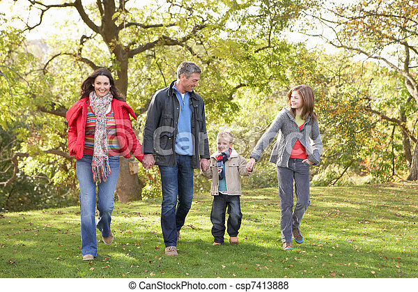 Young Family Outdoors Walking Through Park - csp7413888