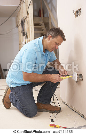 Electrician Installing Wall Socket - csp7414186
