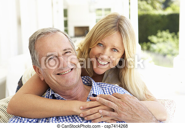Portrait Of Father And Adult Daughter Relaxing On Sofa - csp7414268