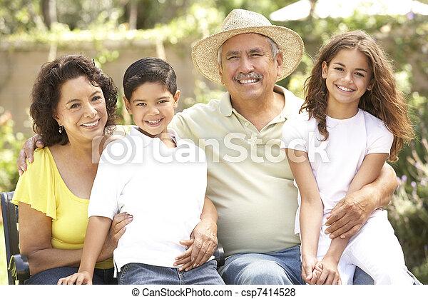 Portrait Of Grandparents With Grandchildren In Park - csp7414528