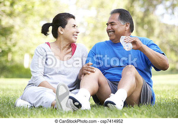 Senior Couple Resting After Exercise - csp7414952