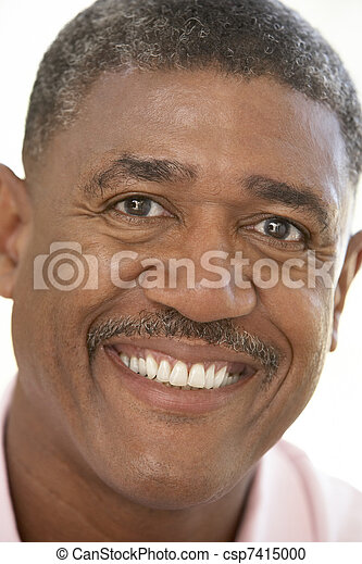 Portrait Of Middle Aged Man Smiling At The Camera - csp7415000