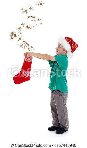 Joyful child releasing stars from Christmas stocking - csp7415940