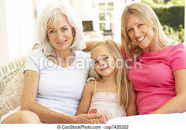 Portrait Of Grandmother, Daughter And Granddaughter Relaxing On Sofa - csp7420322