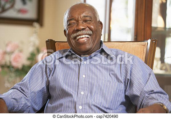 Senior man relaxing in armchair - csp7420490