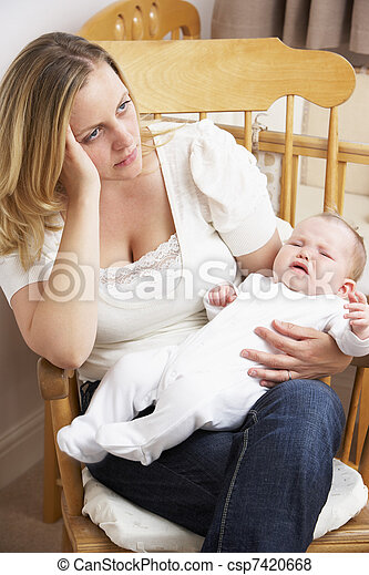 Worried Mother Holding Baby In Nursery - csp7420668