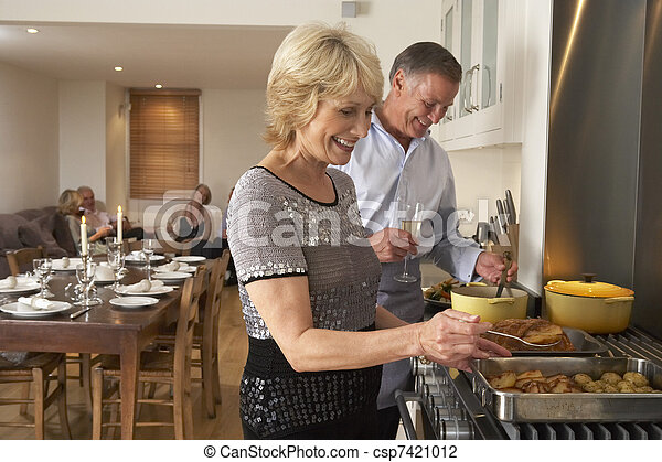 Couple Preparing Food For A Dinner Party - csp7421012
