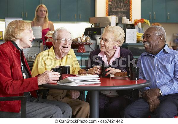 Senior adults having morning tea together - csp7421442