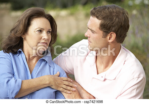 Senior Woman Being Comforted By Adult Son - csp7421698